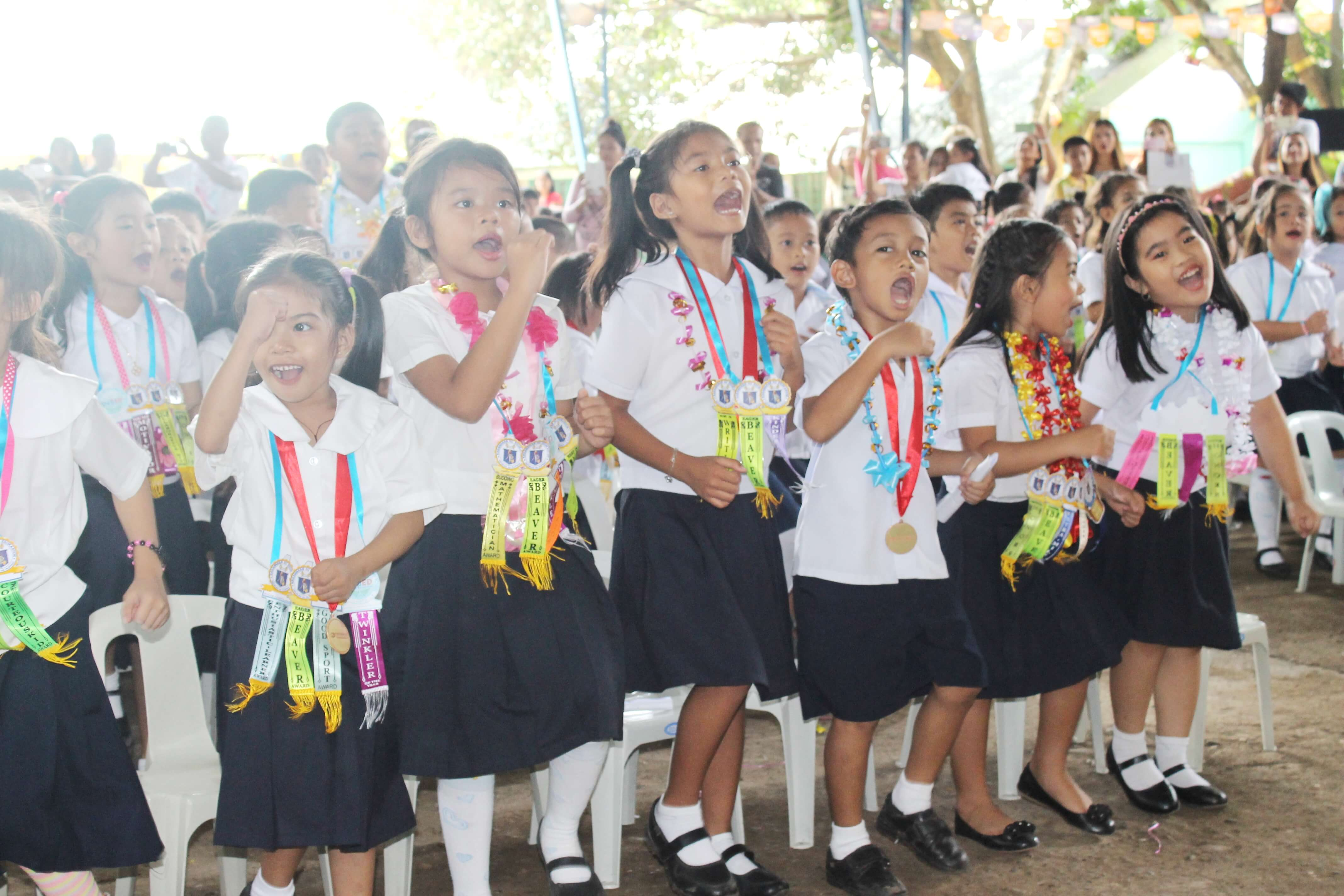 Students of Doña Asuncion Hizon Elementary School in Davao City move up