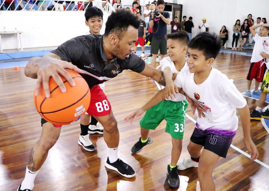 Phoenix PULSE Fuel Masters Basketball Camp - Calvin Abueva in defense